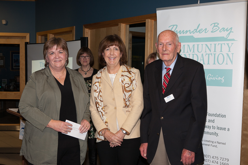 Deborah Kraft (centre) and her father Moe Nelson (right) presenting donation to Rev. Joyce Yanishewski